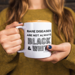 Rare diseases are not always black and white Coffee Mug